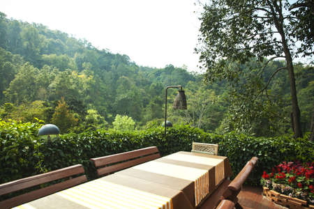 terrace table, wooden balcony table set with mountain view photo