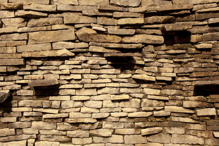 stone wall, texture of brown brick wall made from natural stone Stock Photo - 18418930
