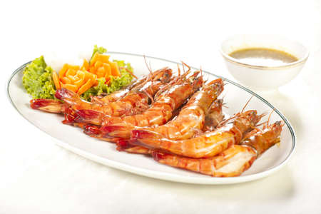 grilled shrimp, orange prawns roasted grill dish with spicy sauce