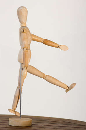 jointed: Jointed wooden mannequin, beige wooden jointed mannequin act walking Stock Photo