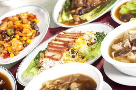 Chinese food, full rounded table of Chinese food, noodle and pork