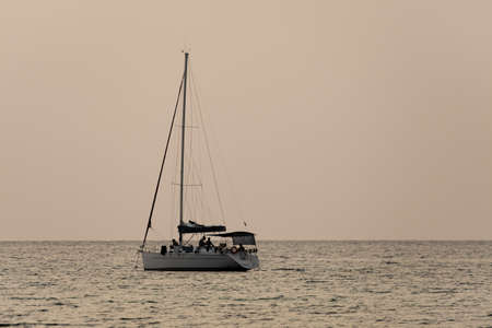 sailing ship, one sailing ship float in the sea\ surface,evening