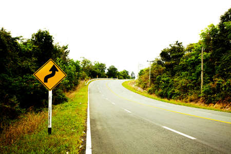 slight: road sign,A slight curve to the left and right warning sign lomo style Stock Photo