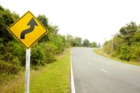 slight: road sign,A slight curve to the left then a slight curve to the right warning sign