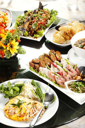 meat soup: mixed food, full rounded table of Chinese Thai food, duck and sauce Stock Photo