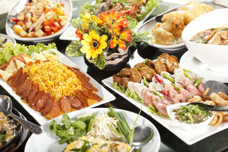 party food: meal time, full round table with colorful food in restaurant