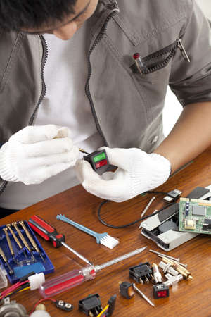 repair man, engineer fixing computer switch part on work table Reklamní fotografie