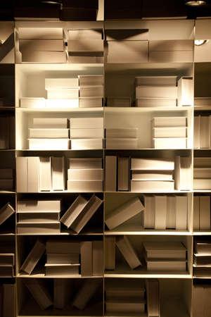 books, white pale book shelf wallpaper in shadow warm lighting photo