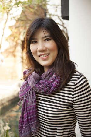 30 something: Asian Girl, a cute Asian 30 something girl wearing purple scarf