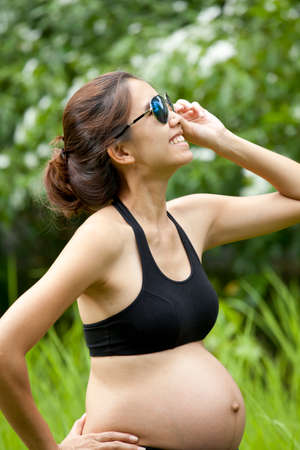 pregnancy woman, Asian pregnancy woman with sunglasses photo