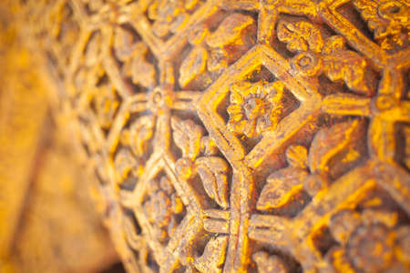 wood carve, a wood pole in Thailand temple carving handmade as pattern of flower photo