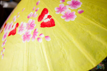 umbrella painting, flower hand paining on yellow umbrella photo