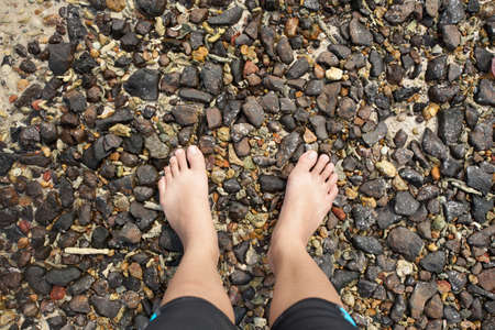 pebble barefoot, female two feet barefoot on pebble ground beach photo