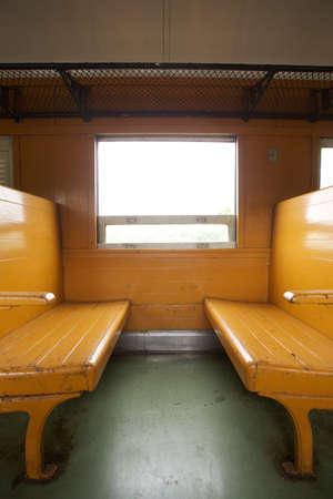 bogie: Train seats, wooden empty seats row on train bogie, Thailand