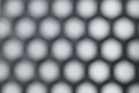 hexagon plastic, close-up to texture surface of hexagon plastic net screen sheet, blur photo