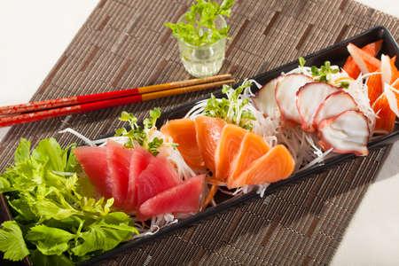 sashimi, raw fish mixed in traditional Japanese style eat with slice daikon radish