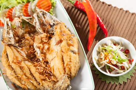 mango fish: fried fish, Thai style fried whole fish with sweet and sour spicy mango salad
