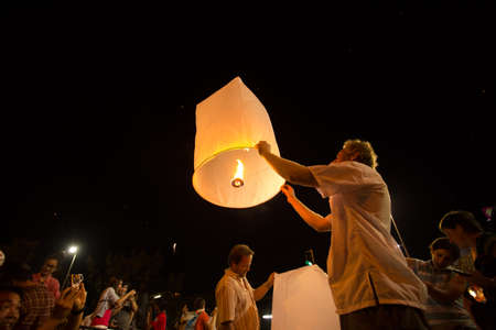 lunar month: CHIANGMAI,THAILAND- NOV 8 People release sky lanterns to worship Buddha s relics in Yi Peng festival on November 10,2013 in Chiangmai,Thailand  This festival occurs on every the 12th Thai lunar month  Editorial