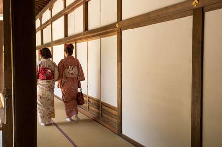 two female in kimono dress walking in temple, japan