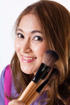 make up artist: Make-up Artist, female Thai beautiful make up artist smile and holding brushes