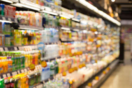aisle: supermarket, blur view of beverage product on refrigerator shelves in supermarket