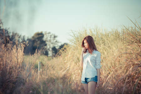 Asian girl relax, an Asian Thai Chinese girl walk relaxing in grass field