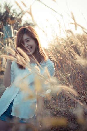 sugar cane farm: girl in nature, female Asian girl happy together in sugar cane farm