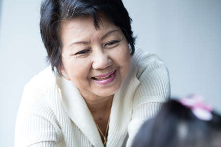 golden age: grandmother, Asian young golden age woman share happiness with granddaughter Stock Photo