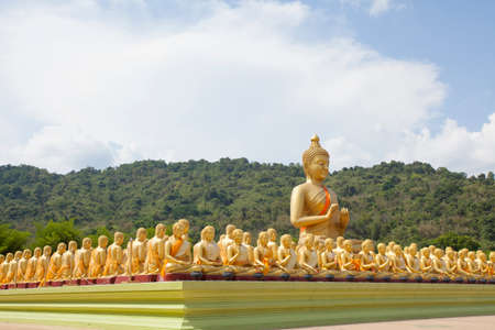 buddha image: Buddha differences image act of golden Buddha with the main Buddha statue outdoor Thailand Stock Photo
