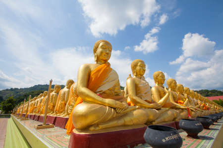 act of god: Buddha differences image act of golden Buddha with the main Buddha statue outdoor Thailand Stock Photo