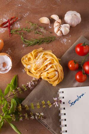 semolina pasta: Pasta menu, Preparation of pasta recipe ingredients with empty notebook written semolina word Stock Photo