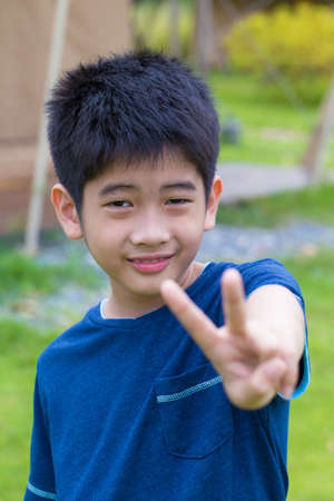 thumbup: Asian young boy, a cute Asian Thai young boy with thumb-up