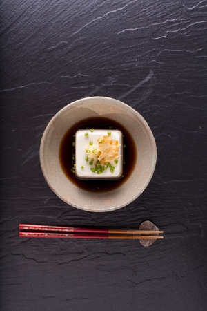 Japanese tofu, Japanese soft cold tofu with sauce in a dish on dining table Reklamní fotografie