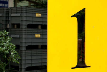 number plate: Number one, yellow metal plate with perforated in number one abstract
