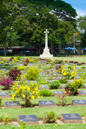 allied: KANCHANABURI, THAILAND -July 26,2014: The Kanchanaburi World War Cemetery with graves of 6,982 Allied, Commonwealth, and Dutch POWs who perished building Japans infamous Death Railway