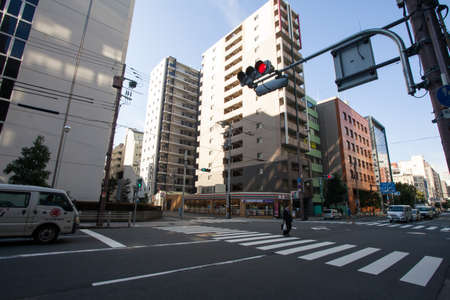 cross walk: Cross walk at the intersection showing street traffic light and clean road in Osaka city, Japan 5 Nov 2015