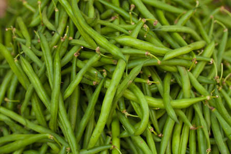 greenbeans: Lot of green bean put in weave basket local style sell in fresh market, Vietnam