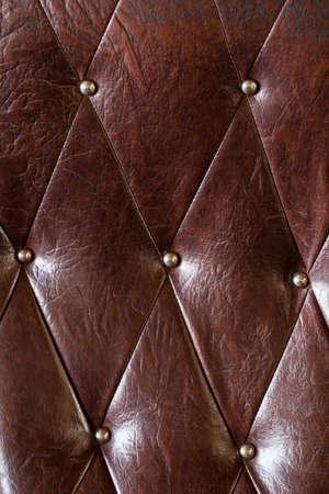 padding: Vintage padding, Texture of brown vintage padding cushion. Stock Photo