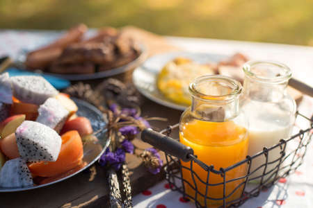 tomate de arbol: Various breakfast table with fruits egg and sausage, orange juice and milk
