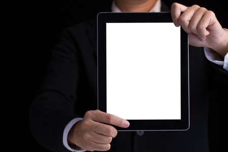 blank tablet: A business man holding blank digital tablet showing copy space.