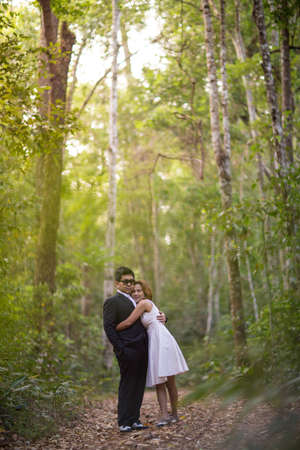 prewedding: A couple in formal dress black suit and white dress romance in the pine forest before wedding, Thailand