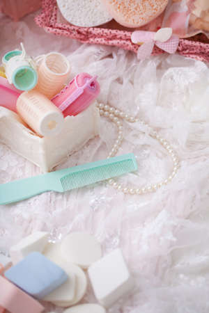 salon: Beauty cosmetic tools and hair accessories in basket. Stock Photo