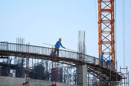 silhouette of man working for building.