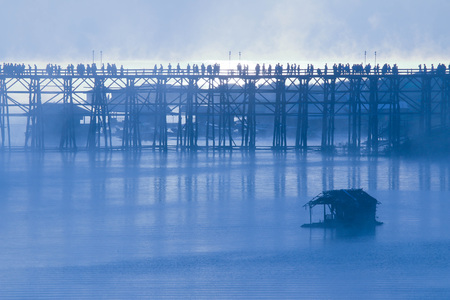 Wooden bridge of Sangklaburi in Kanjanaburi province,Thailand, Morning day. Stock Photo