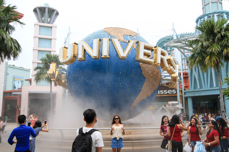 SINGAPORE - JULY 9, 2017 : Tourists taking pictures in front of Universal Studios (Sentosa island).