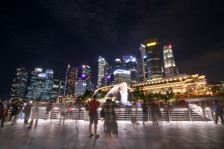 SINGAPORE-JULY 7, 2017 : Tourists taking pictures in front of Merlion. Editorial
