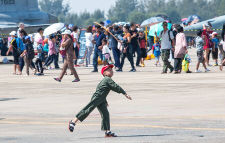 BANGKOK, THAILAND - January 12 , 2019 : Cute little boy playing with a toy airplane, Children's Day at Royal Thai Airforce Base Don Mueang.