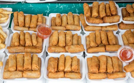 spring rolls on the local market at Chatuchak weekend market Bangkok, Thailand street food.