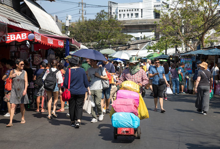 BANGKOK, THAILAND - February 23, 2019 : crowd of tourist and people shopping in Chatuchak outdoor street weekend market, this place is a famous and popular travel destination in Bangkok.