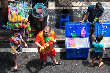 BANGKOK, THAILAND - April 15, 2019 : Tourists shooting water guns and having fun at Songkran festival, Silom Road in Bangkok.